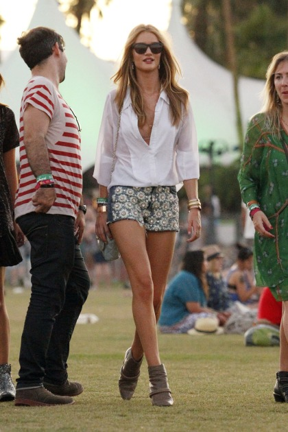 RING ALERT! Gorgeous model/actress Rosie Huntington-Whiteley is seen with a ring on her engagement finger as she enjoys the Arctic Monkeys set while drinking and dancing with friends at the Coachella Music Festival