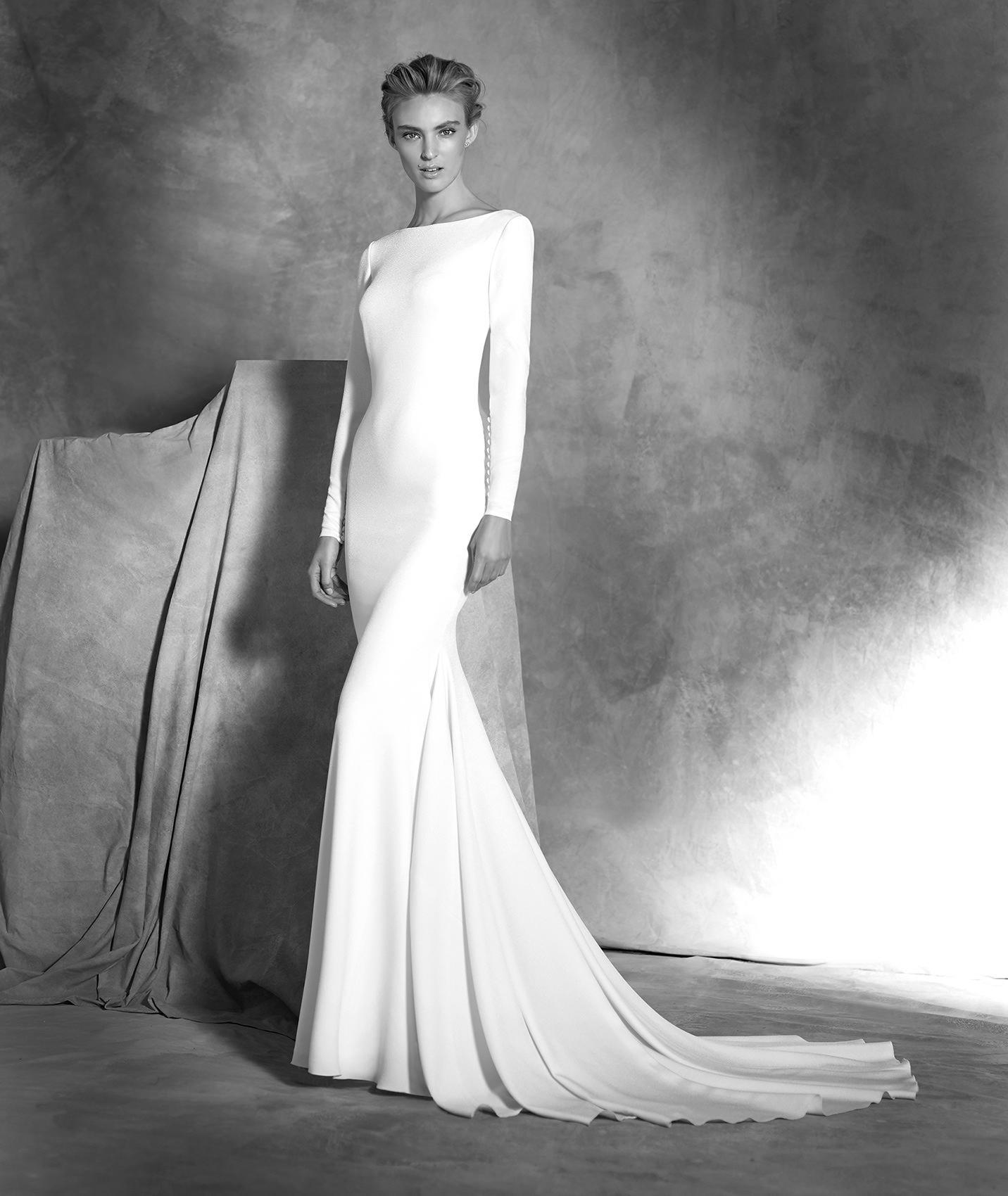 Vestidos de novia manga larga sirena sobrefalda